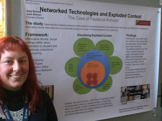 Standing next to our poster. Photo credit to my co-presenter, Gary Burnett